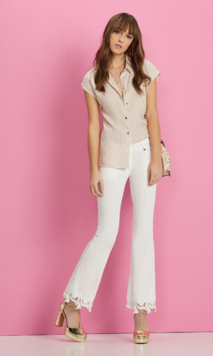 Trousers in cotton textile with lace and zips.